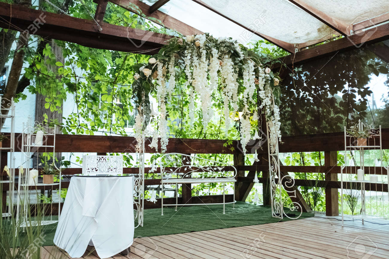 Wedding Arch Decorated With Hanging Flowers Stock Photo, Picture And ...