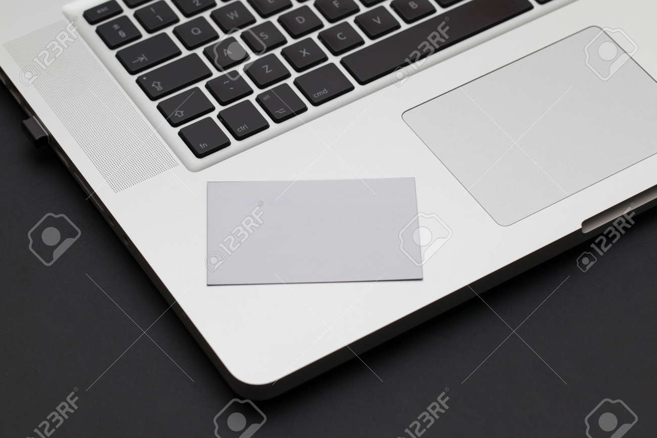 Business card on a laptop keyboard Stock Photo - 18092258