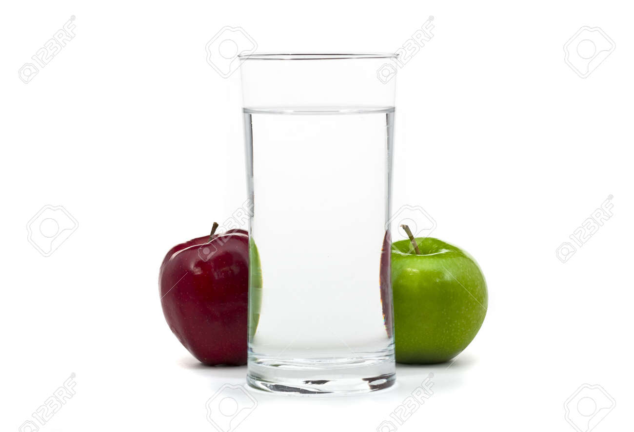 Red and green apple with glass of water in the middle over white background Stock Photo - 6798241