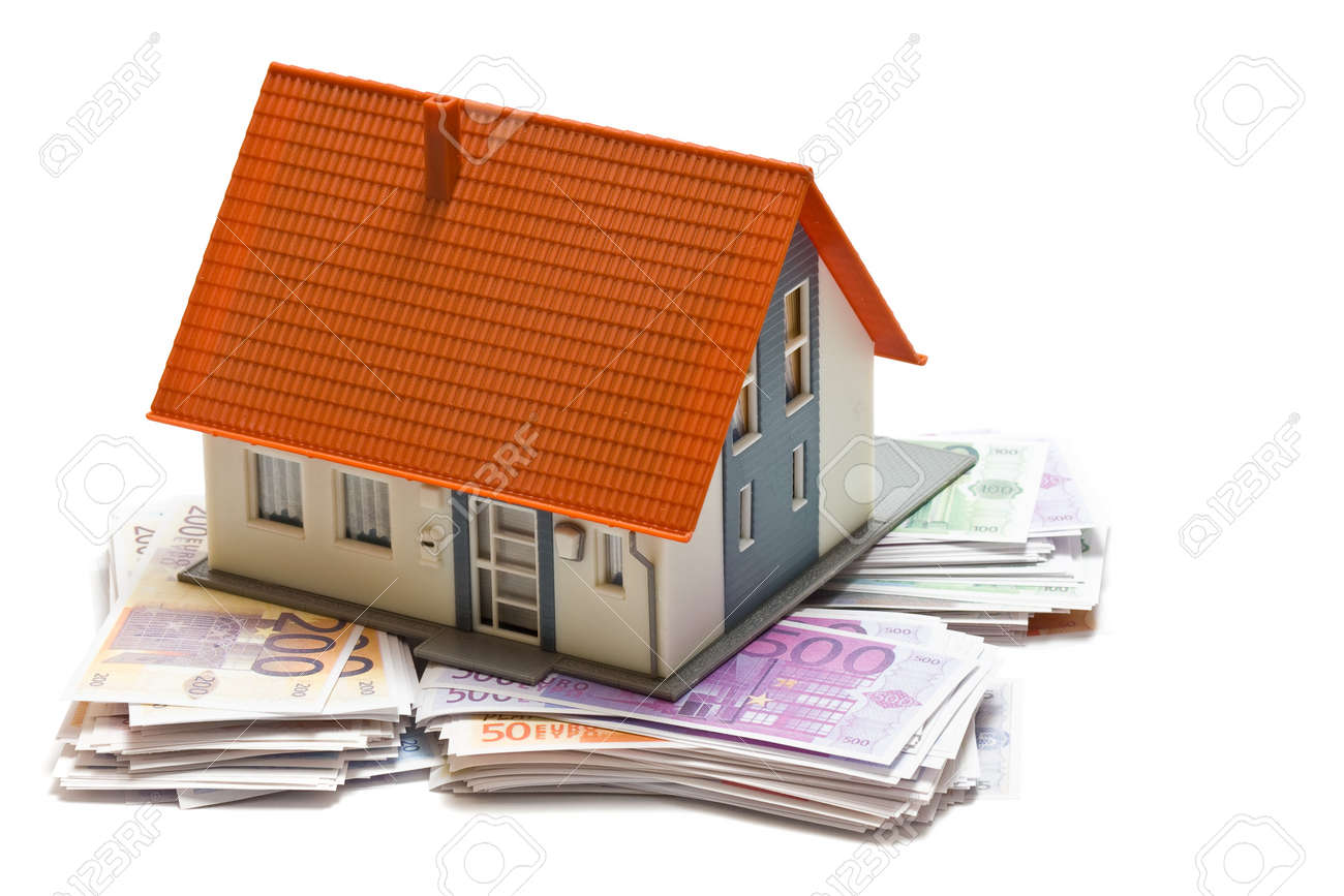 House with money over white background - mortgaging concept Stock Photo - 7972137
