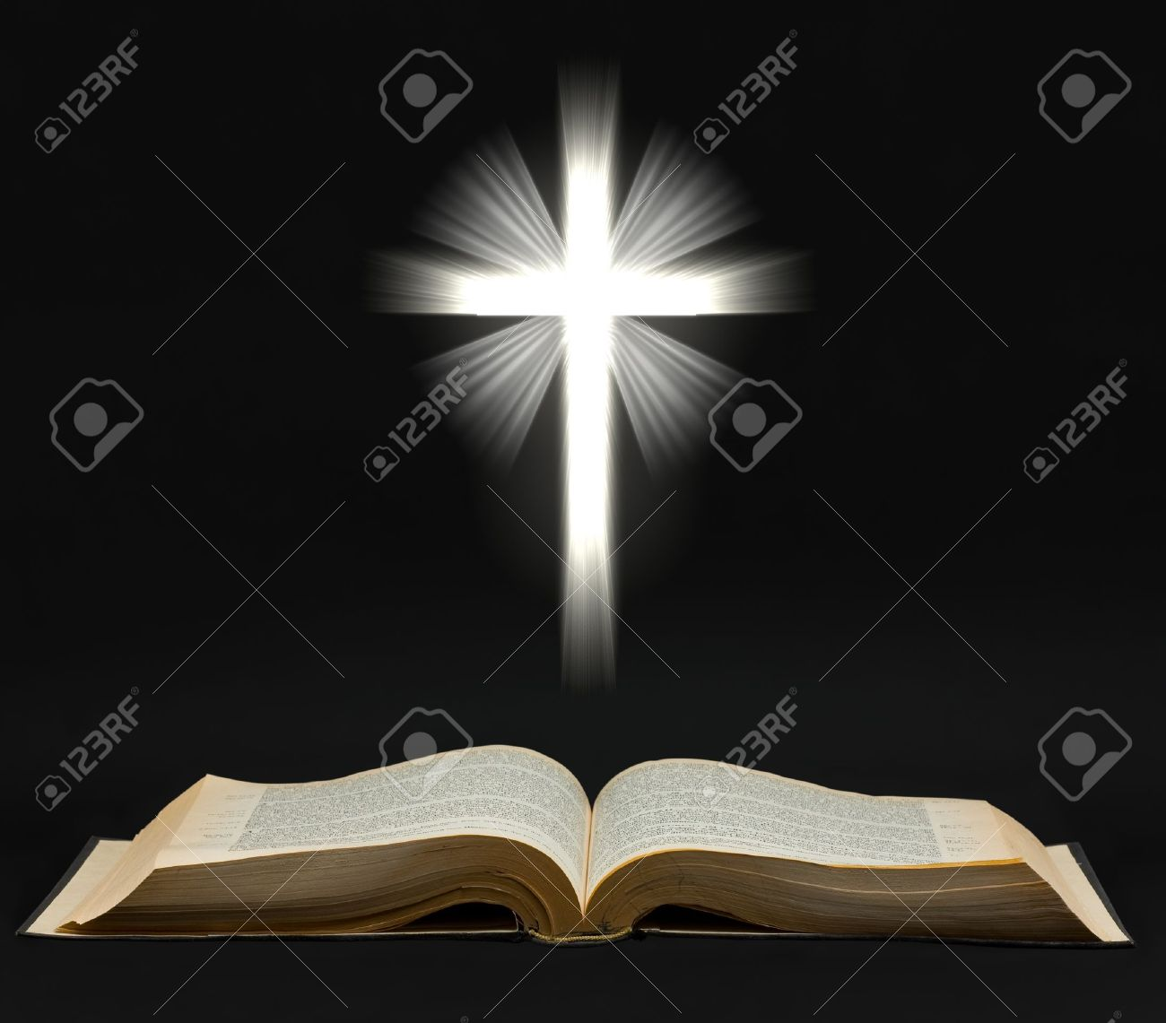 Holy bible with shining cross over black background Stock Photo - 8573691