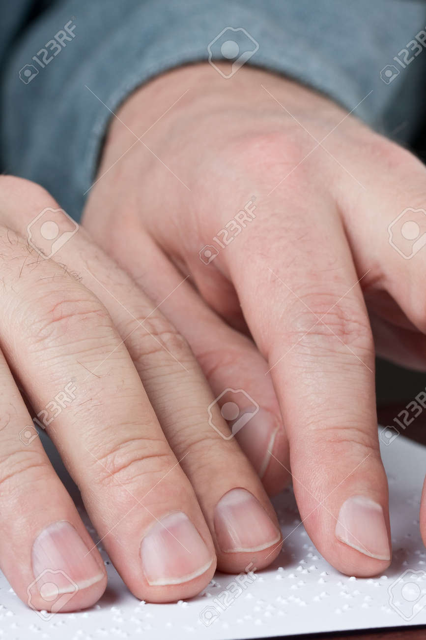 Close up of male hands reading braille text Stock Photo - 8747462