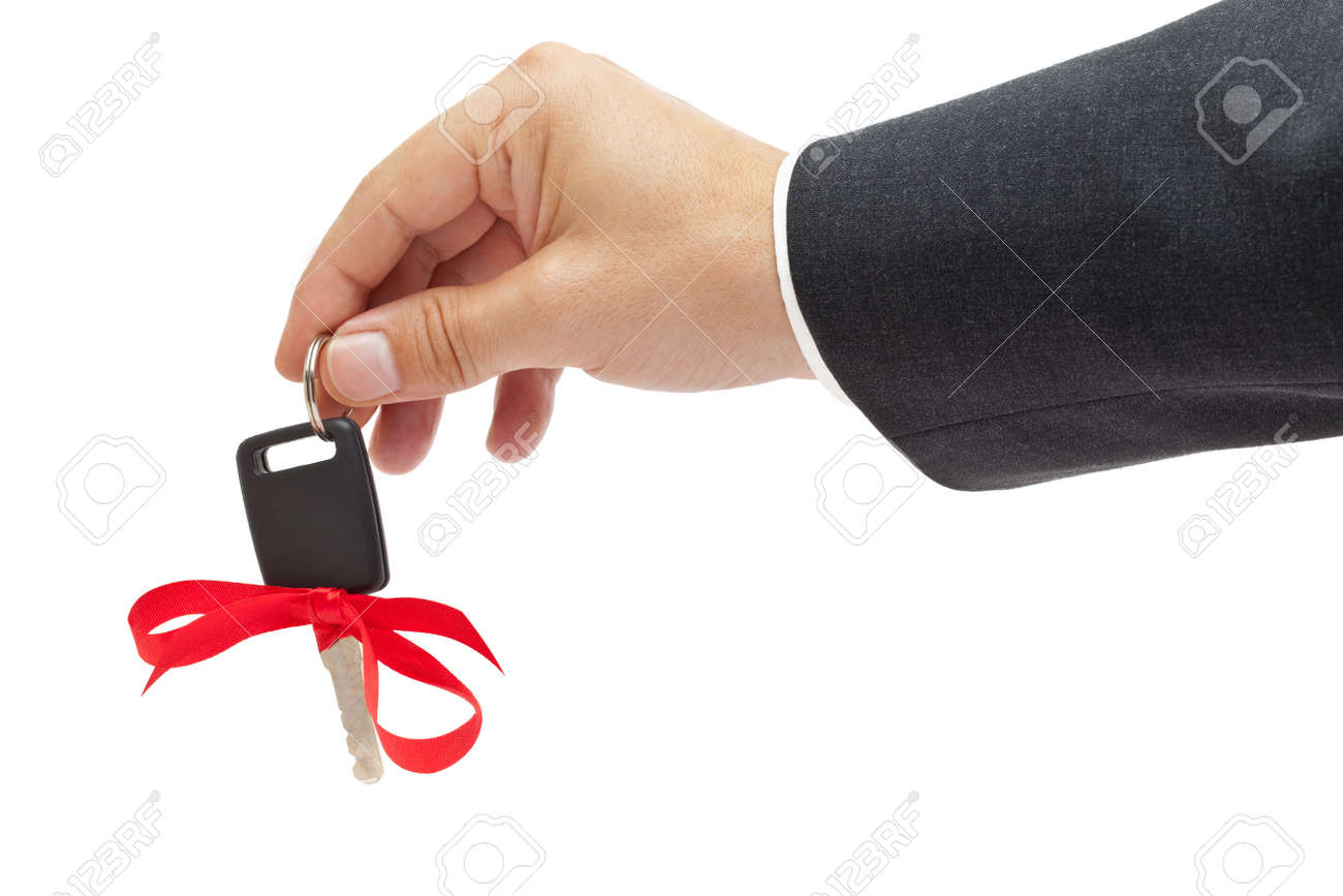 Handing over car key with red bow as a present Stock Photo - 10554721