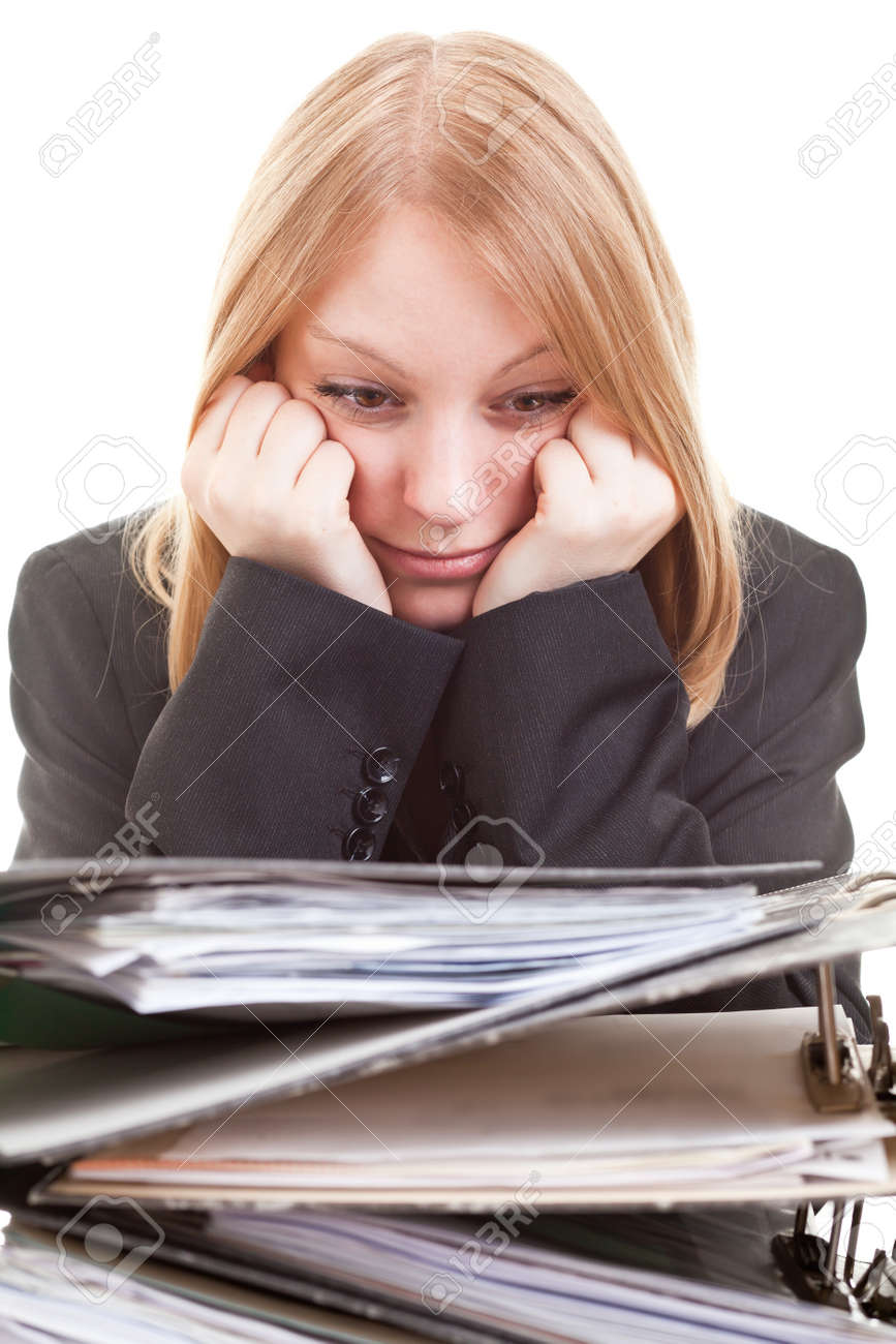 Young Businesswoman Overworked Behind A Huge Stack Of Folders