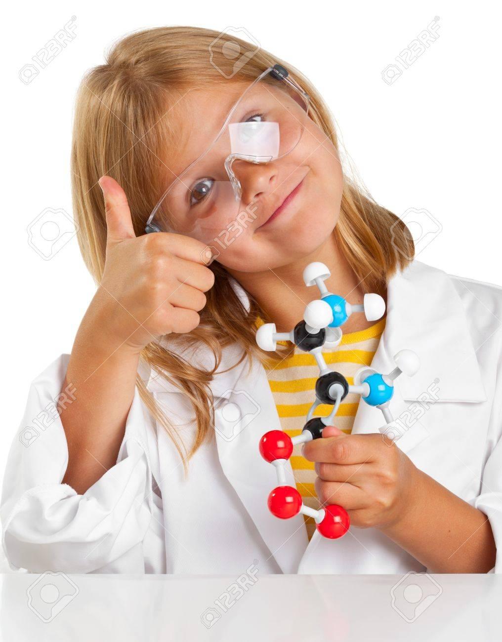 Cute young girl doing science experiements Standard-Bild - 14615541