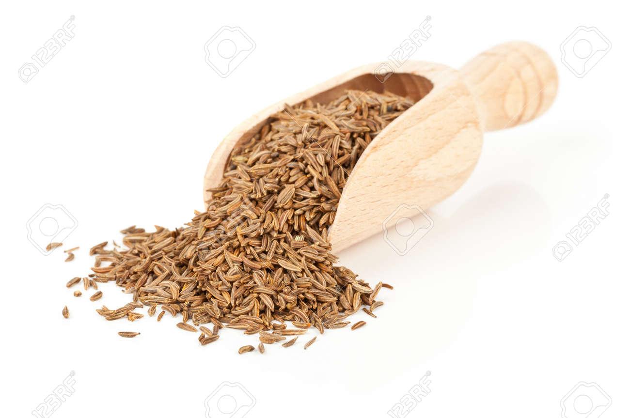 Caraway  Cumin seeds in wooden scoop over white background Standard-Bild - 15557849