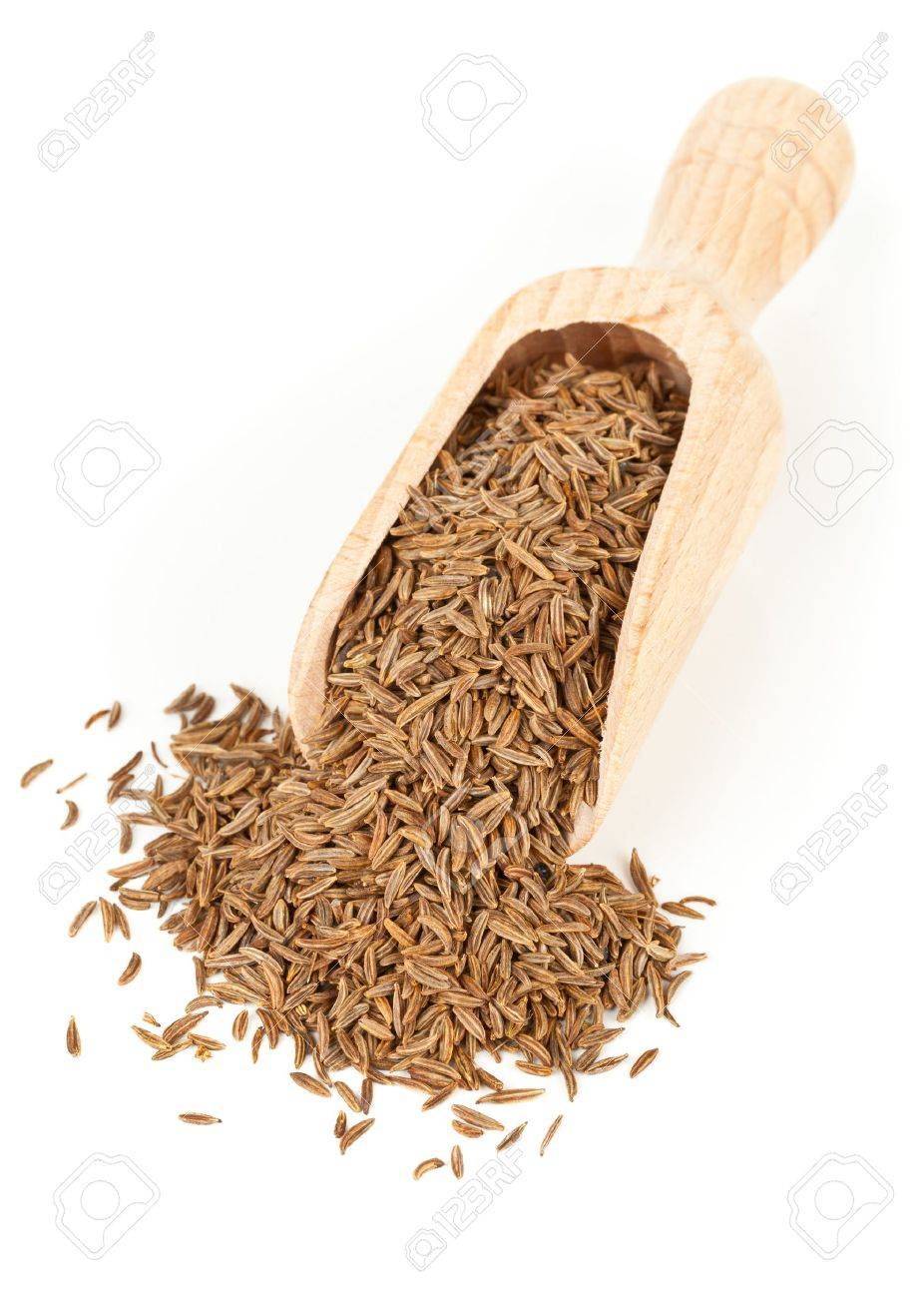 Caraway  Cumin seeds in wooden scoop over white background Standard-Bild - 15557854