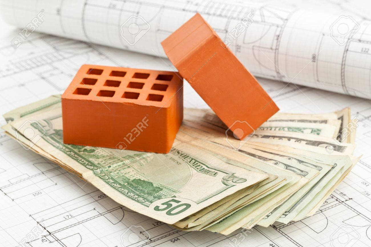 Brick homes blueprints - Brick Stones With Dollar Banknotes On Home Construction Blueprints Home Or Construction Financing Concept Stock