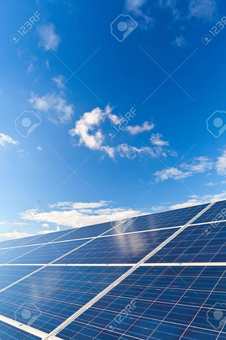 Solar photovoltaics panels field for renewable energy production with blue sky and clouds Standard-Bild - 16049741