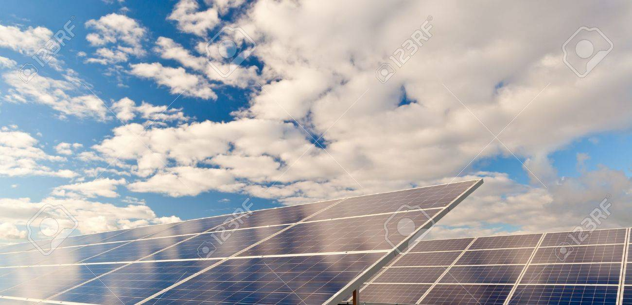 Solar photovoltaics panels field for renewable energy production with blue sky and clouds Standard-Bild - 16049739