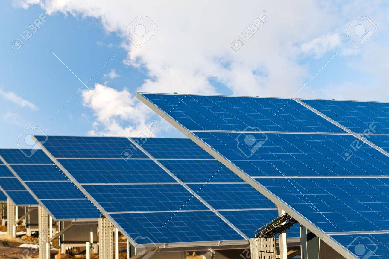 Solar photovoltaics panels field for renewable energy production with blue sky and clouds Standard-Bild - 16452161