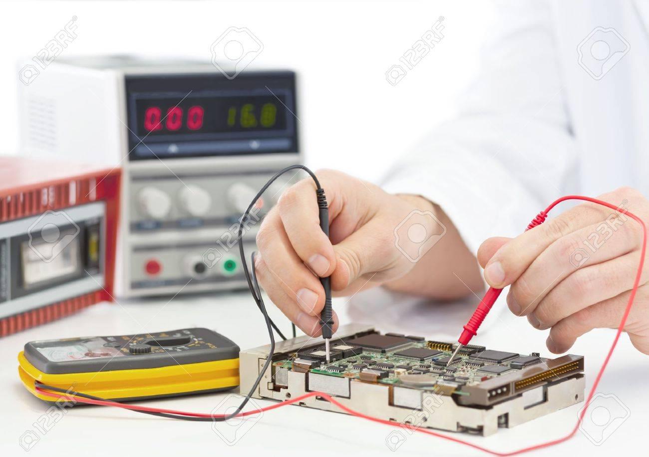 Electronics engineer testing computer part in electronics workshop Standard-Bild - 16452079