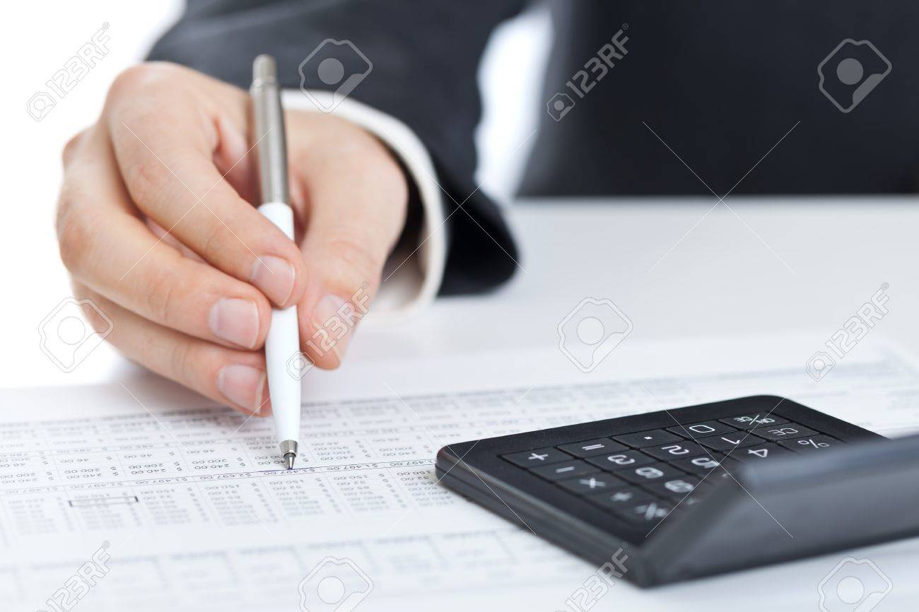 Business finance man calculating budget numbers with calculator Standard-Bild - 16451967