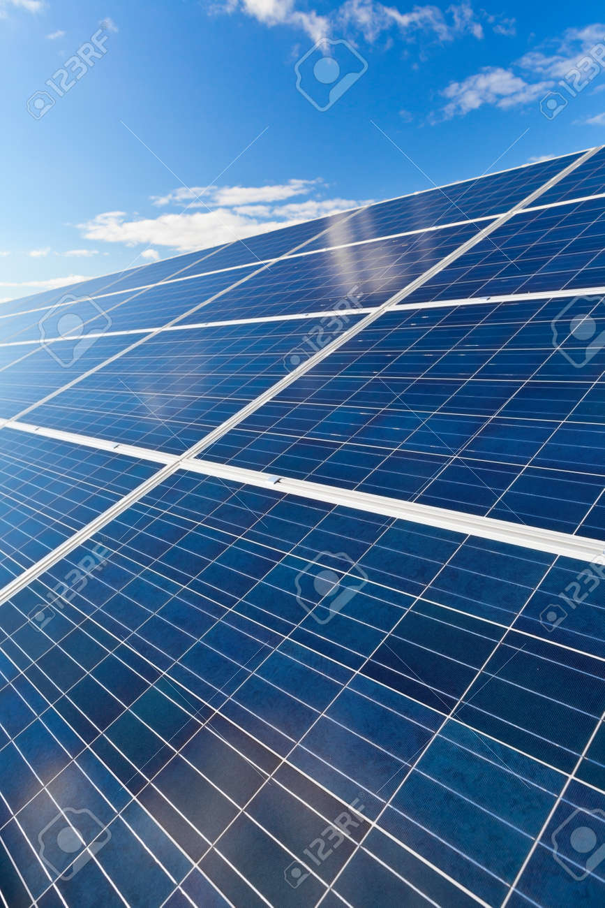 Solar photovoltaics panels field for renewable energy production with blue sky and clouds Standard-Bild - 17466091