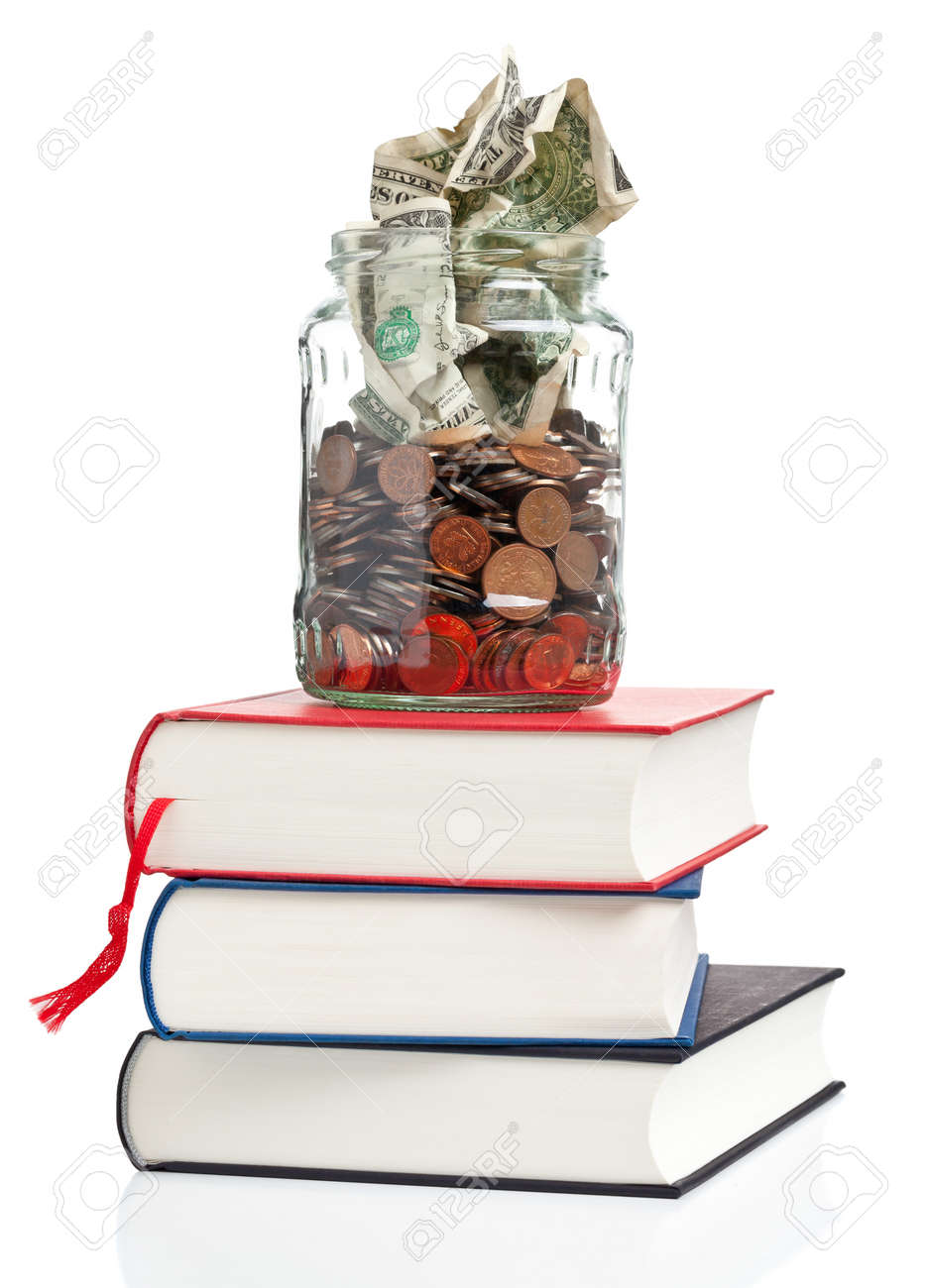 Books with penny jar filled with coins and banknotes - tuition or education financing concept Standard-Bild - 18586916