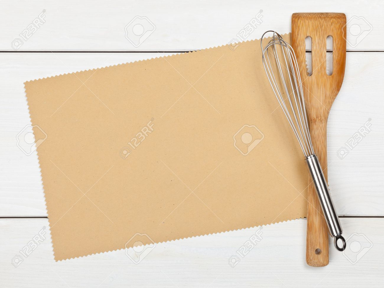 Empty paper for recipe with cooking utensils on kitchen table Standard-Bild - 19424100