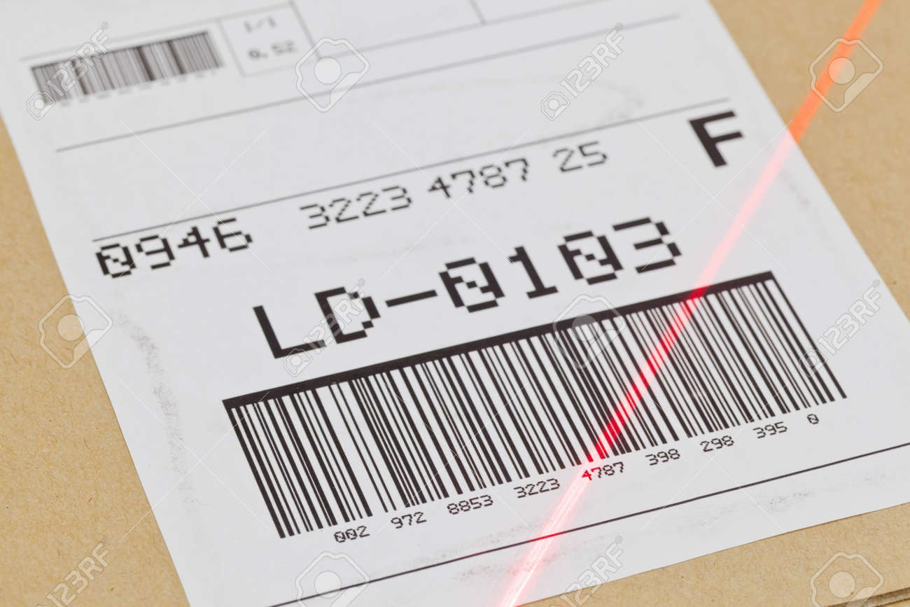 Barcode on shipping label on box scanned by automatic laser scanner Standard-Bild - 25111993