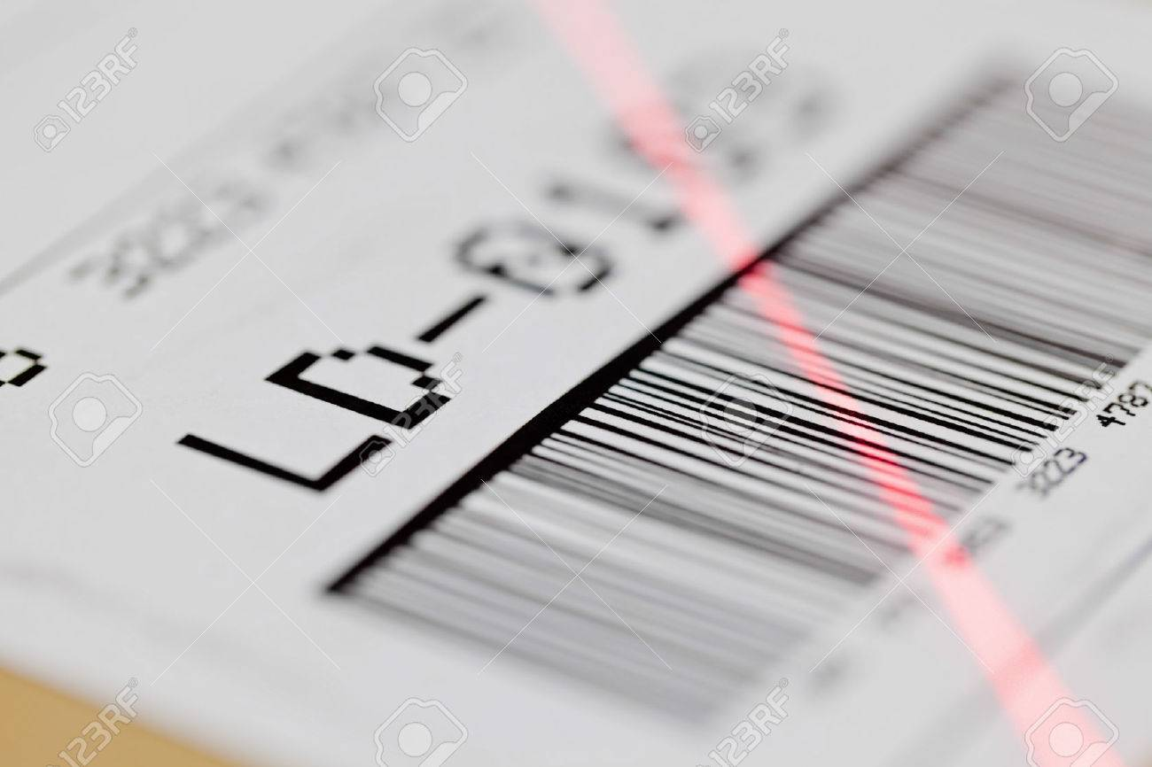 Barcode on shipping label on box scanned by automatic laser scanner Standard-Bild - 26455238