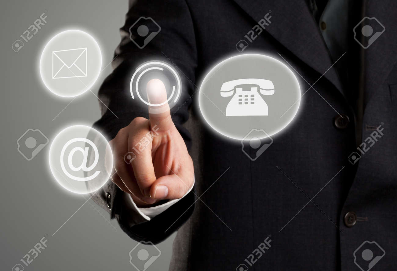 Businessman touching virtual futuristic display with icons for phone, mail and e-mail contact information Standard-Bild - 29272690