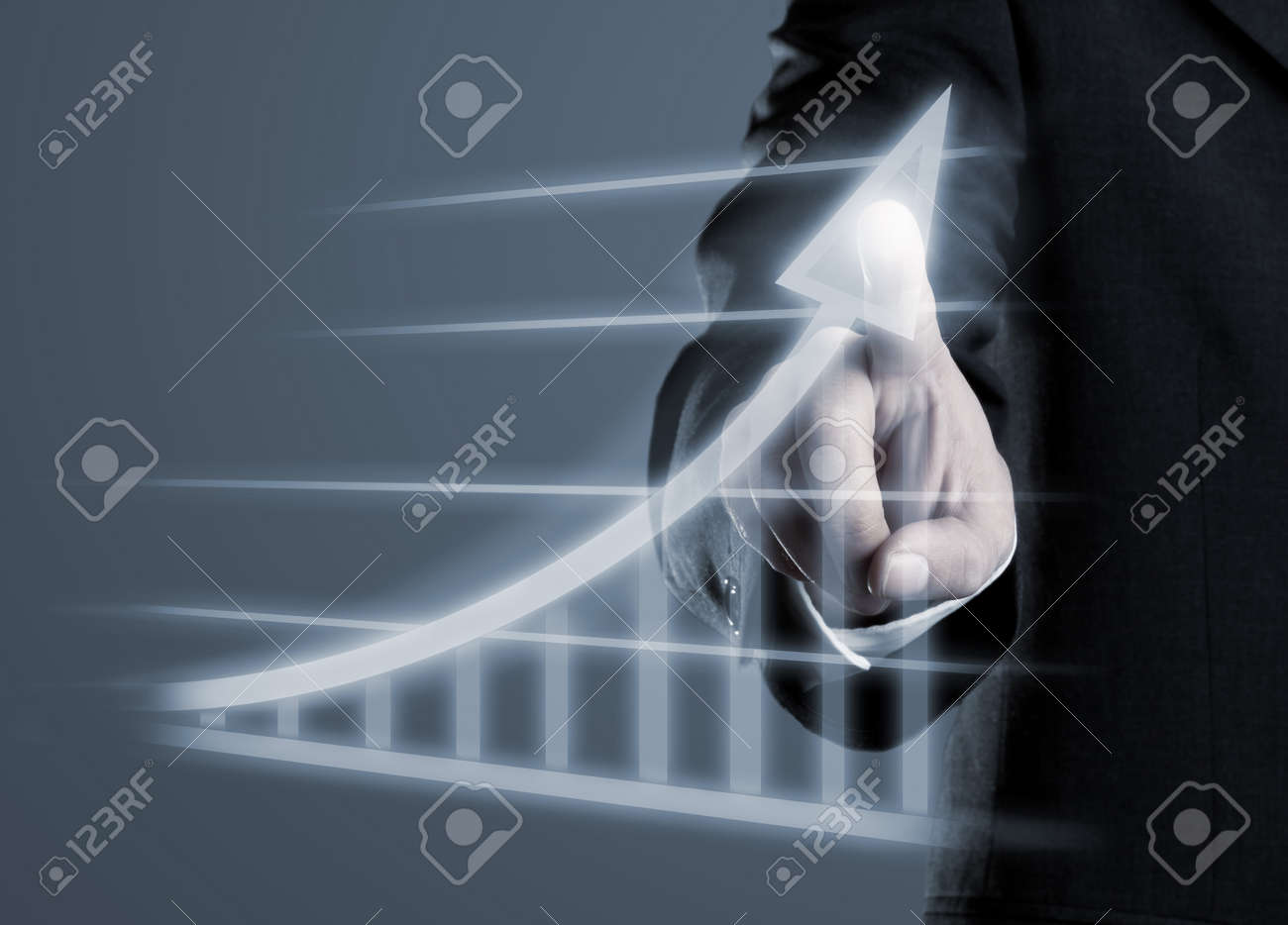 Businessman drawing success graph on virtual futuristic computer display Standard-Bild - 30155233