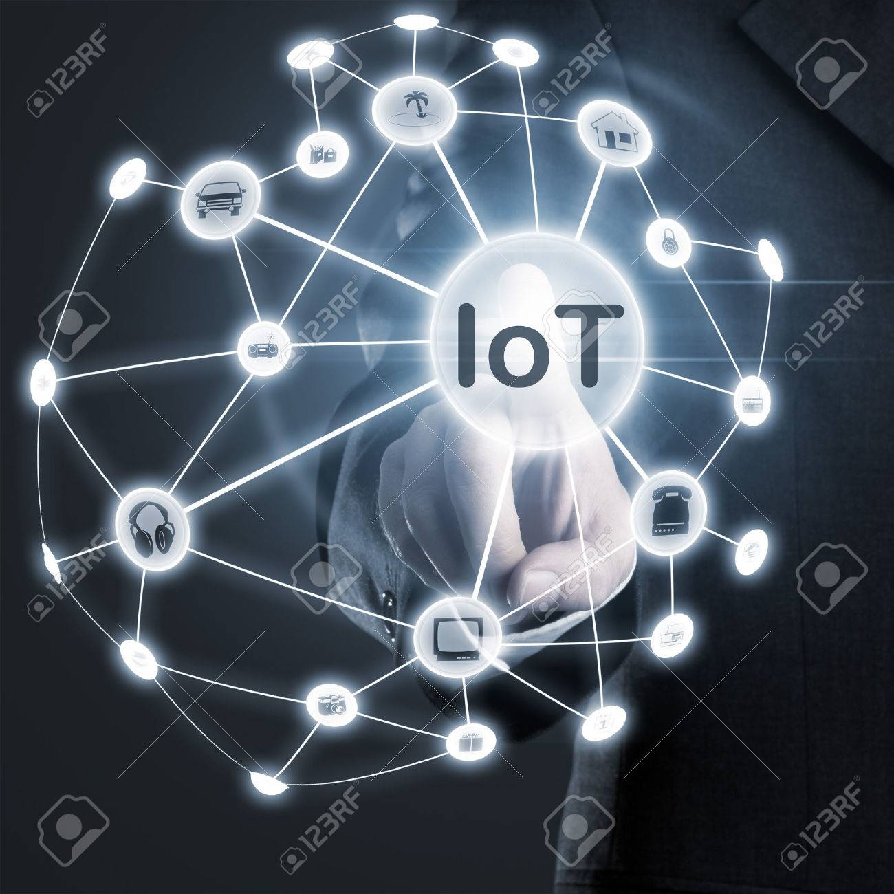 Man touching IoT (internet of things) network on display Standard-Bild - 44250002