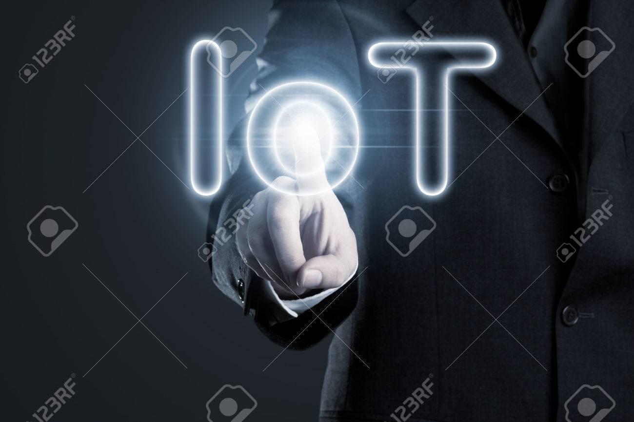 Man touching IoT (internet of things) text on display Standard-Bild - 45075464