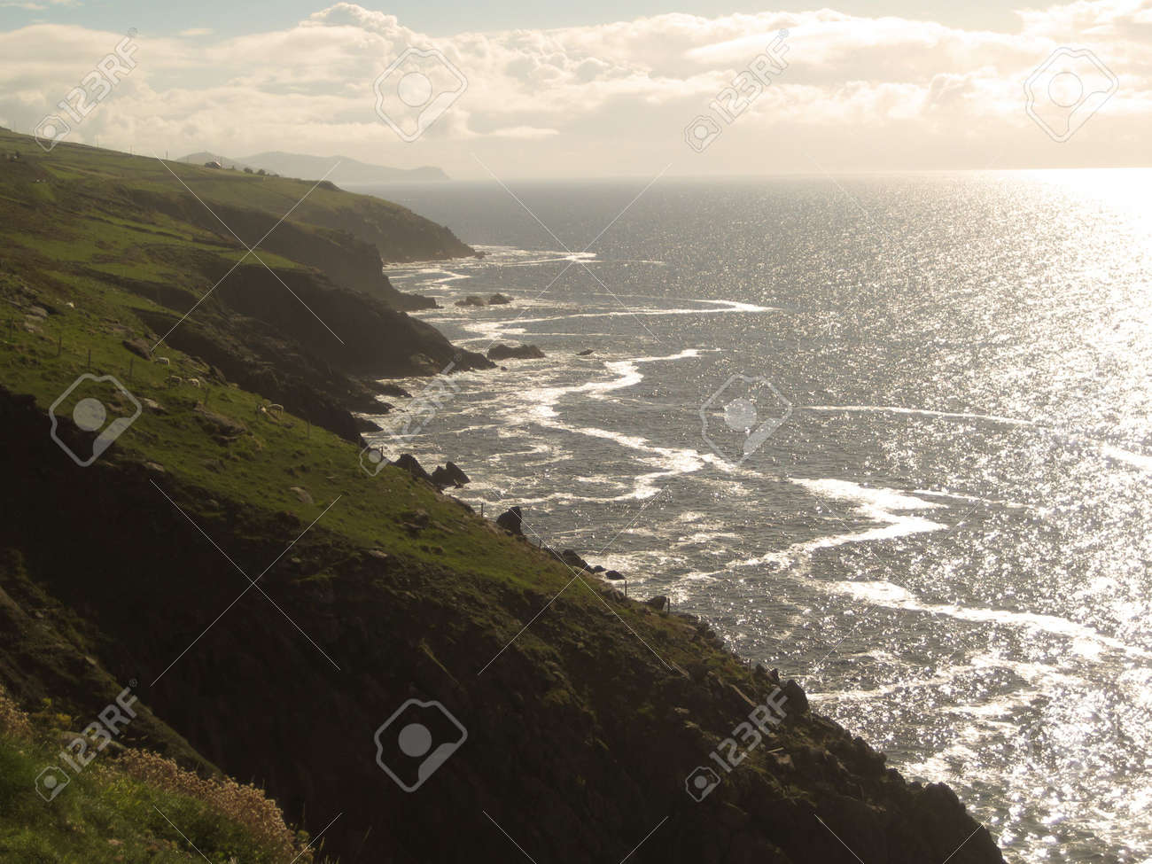A magnificent view of green land and ocean from the Ring of Kerry, Ireland Stock Photo - 7869671