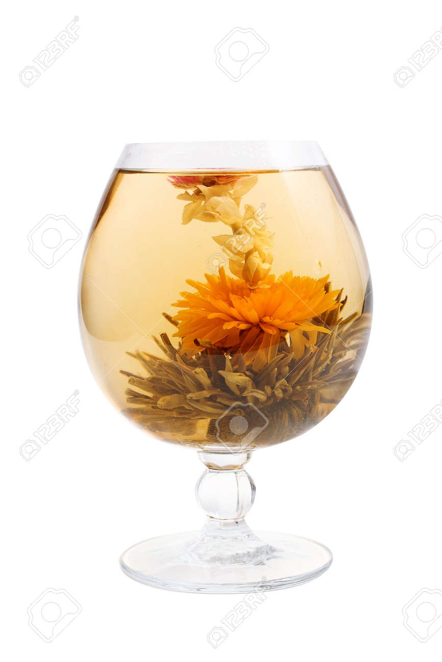 Glass with a blooming flower green tea on white background Stock Photo - 2744509