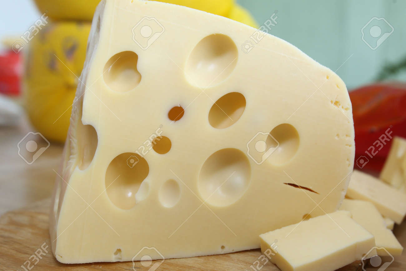 The Perfect Piece Of Swiss Cheese And Various Types Of Cheese