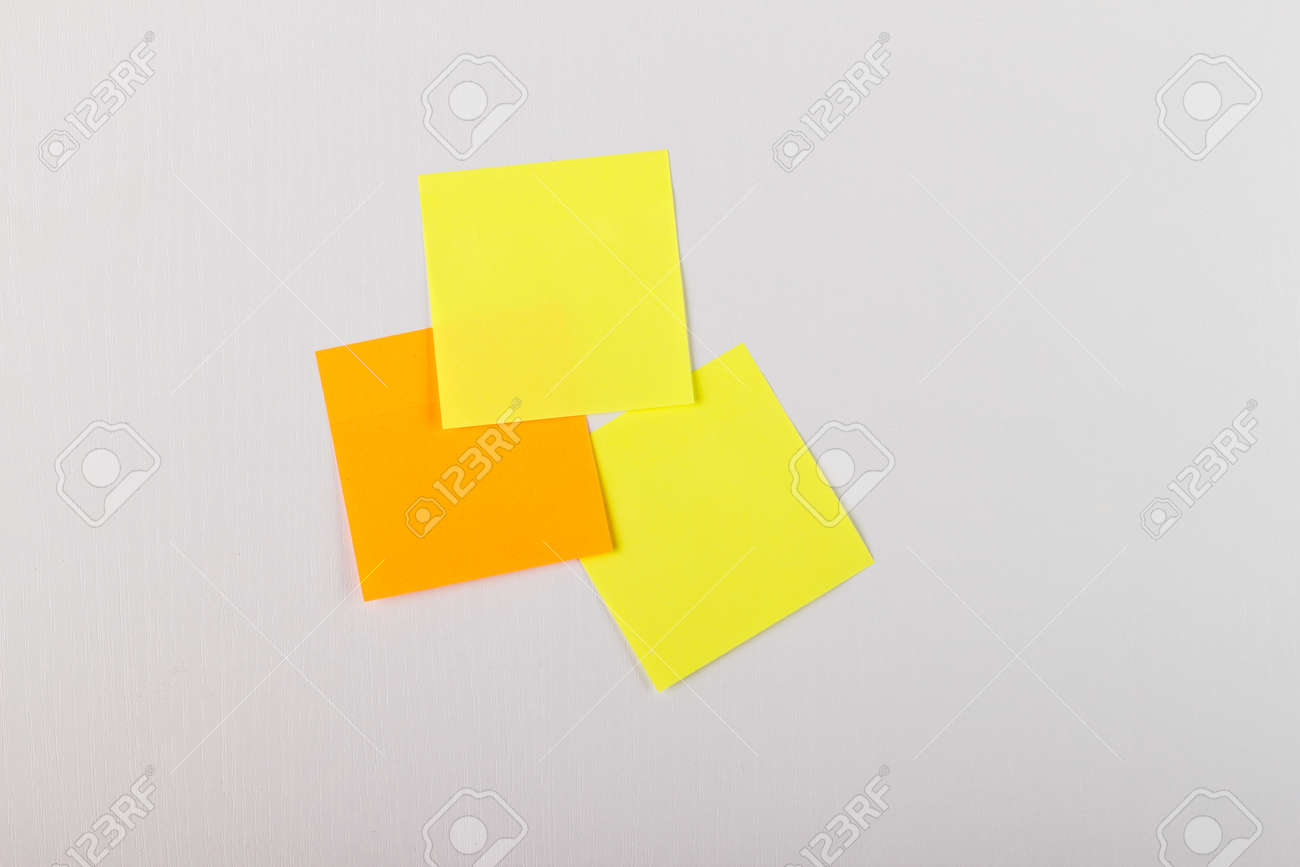 Wooden Board With Five Blank Colorful Sticky Notes Stock Photo