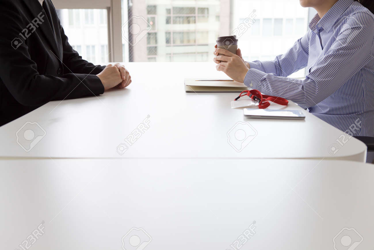 Businesswoman have an interview in the office face to face over a cup of coffee Stock Photo - 50252113