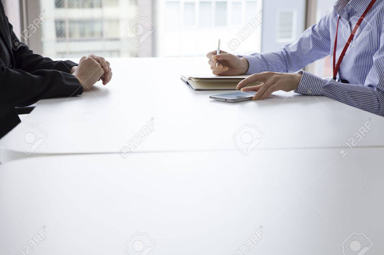 Businesswoman have an interview in the office face to face while taking notes Stock Photo - 50252116