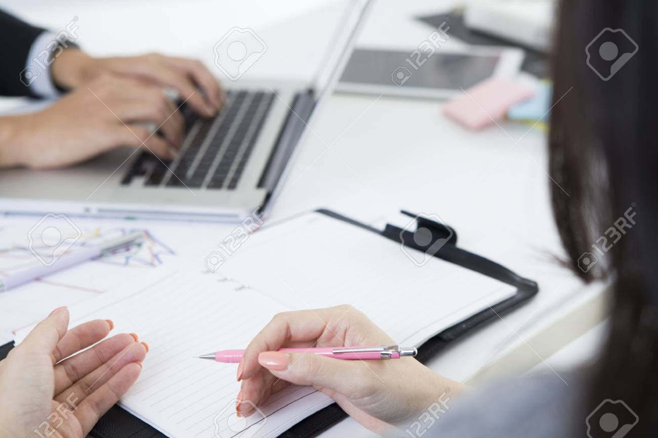 Businessman is input to a laptop during a meeting Stock Photo - 50591104