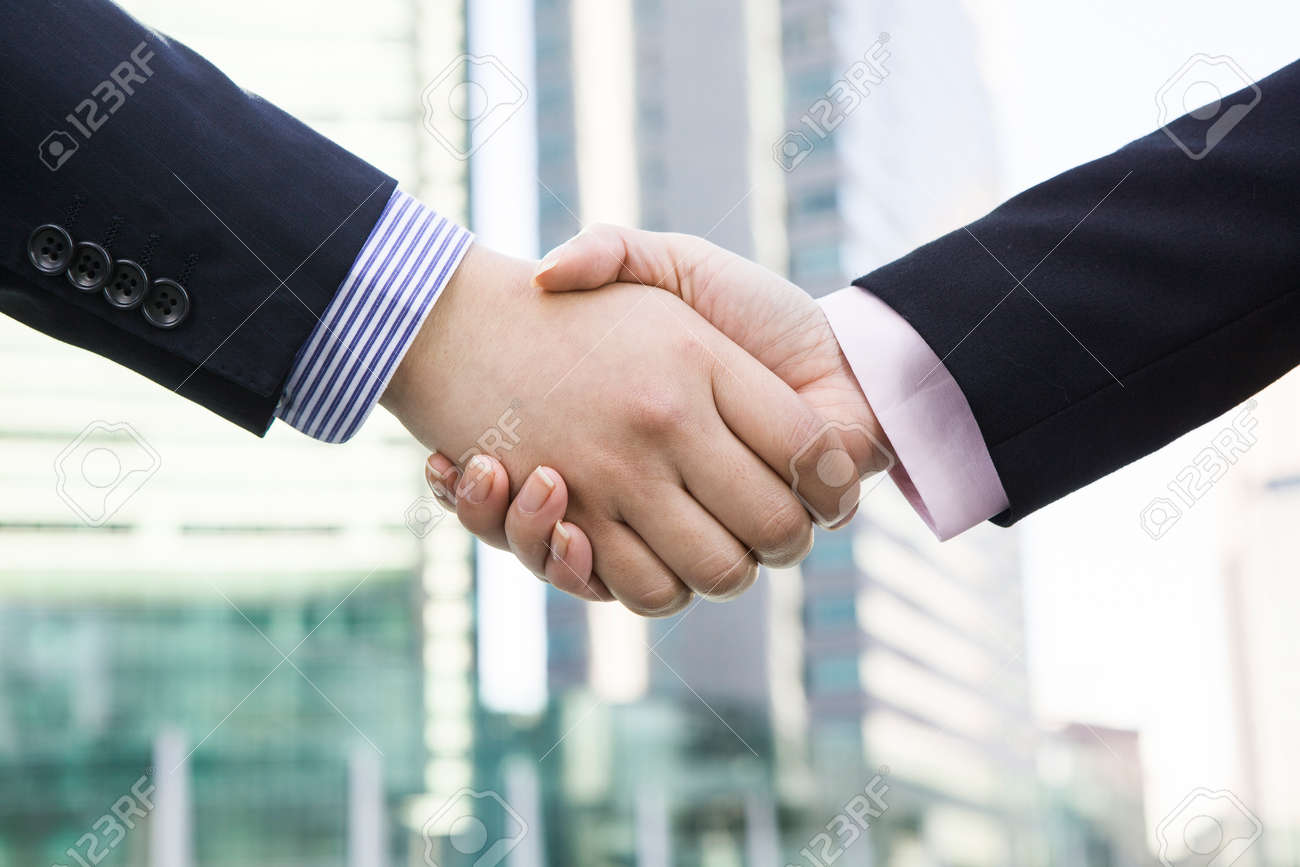 Office workers shaking hands - 52400346