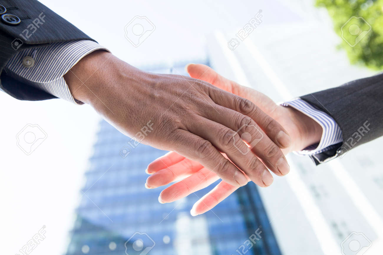 Office workers shaking hands - 52338488