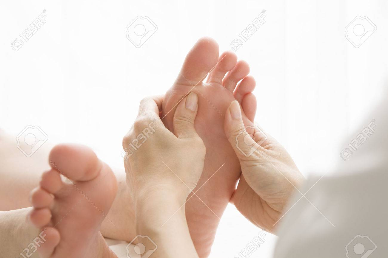 Woman to a foot massage Stock Photo - 51174365