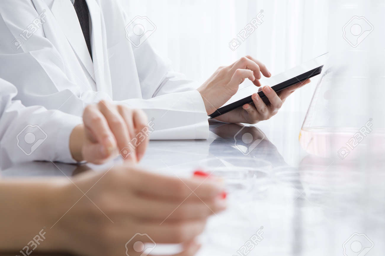 Researchers are using electronic tablet in the laboratory - 50948804