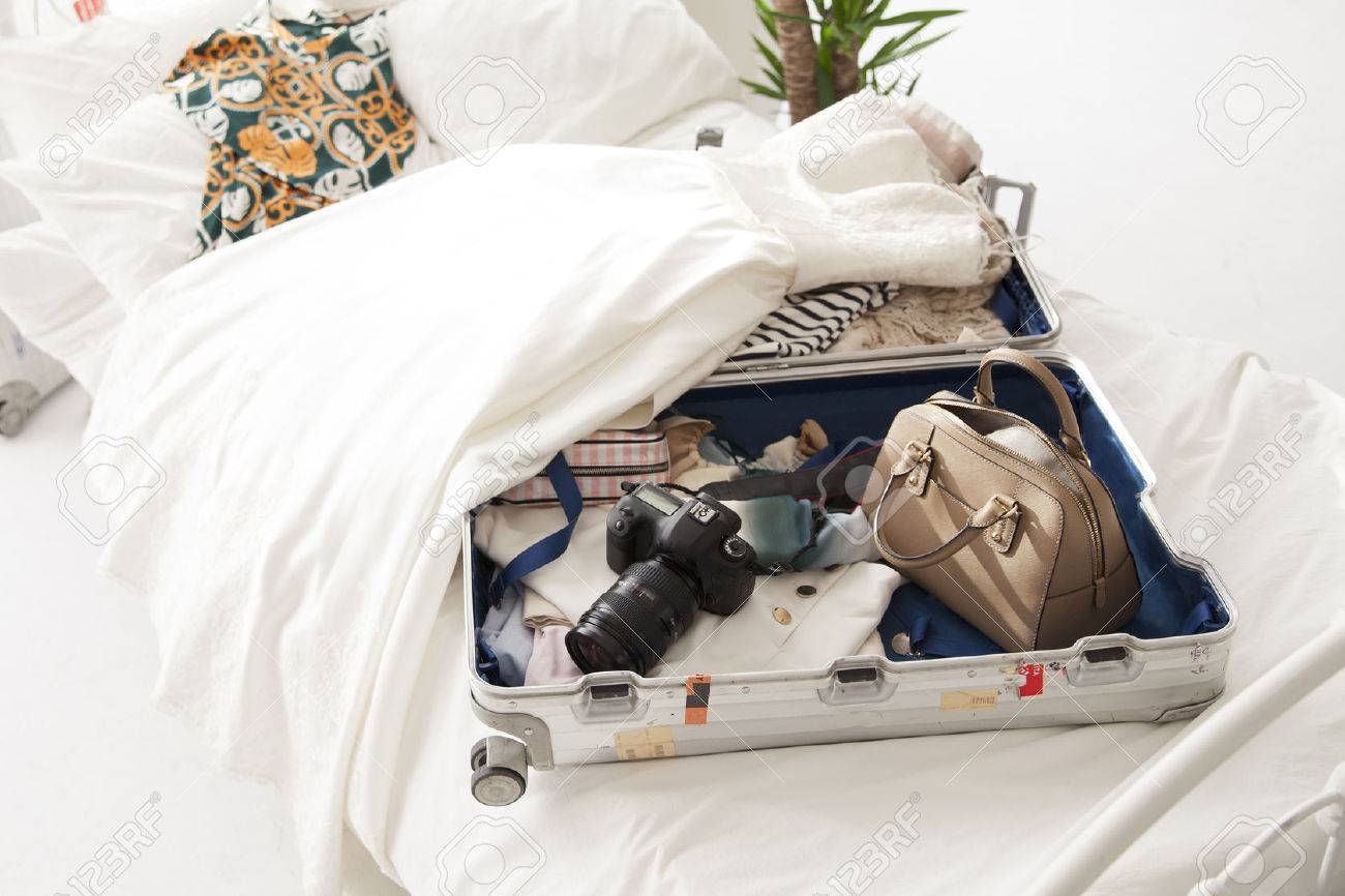 The stuff in the suitcase, clothes and dreams and hope and joy. Stock Photo - 57615831