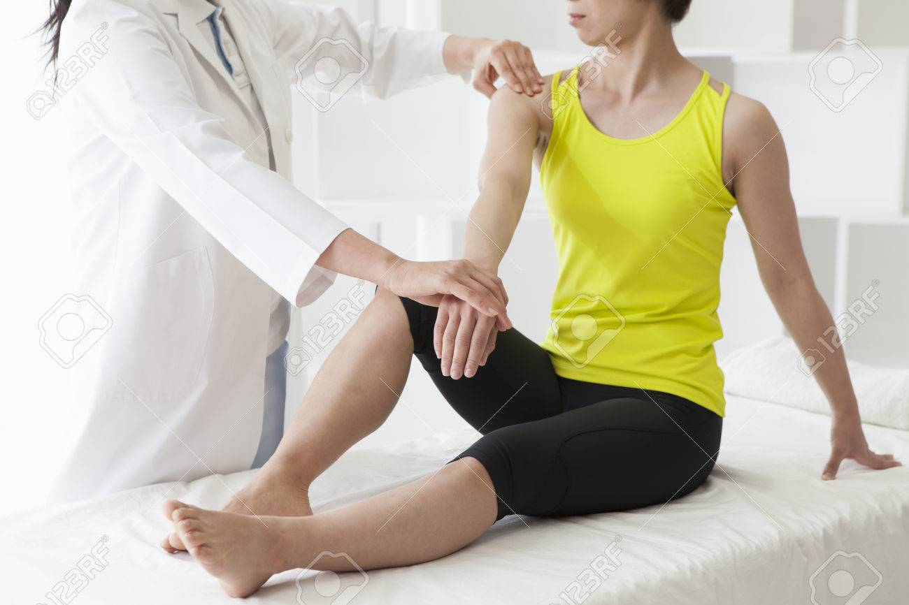 Therapist doing rehabilitation massage with hands on female... - 60457008