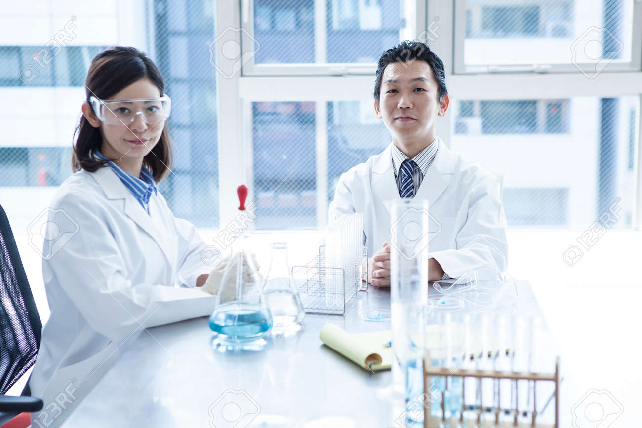 Two young researchers at work. - 60457250