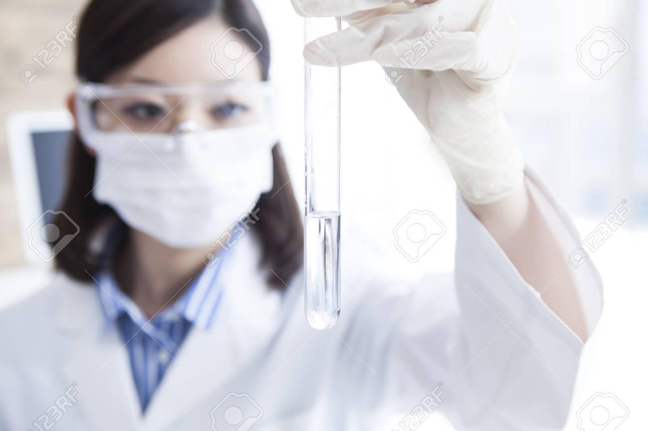 Woman researcher of close windp. - 60458474
