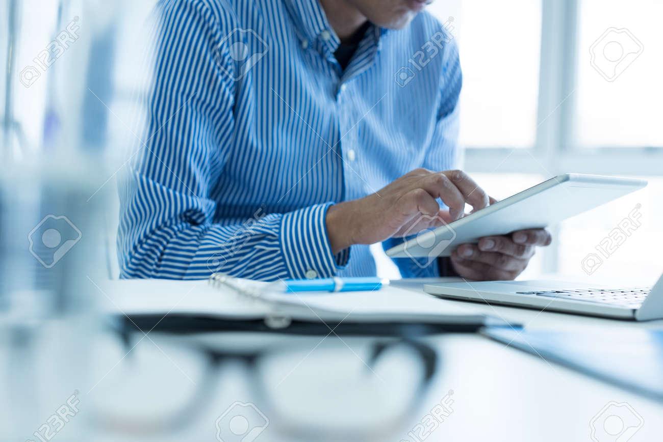 Businessman is using smart tablet. - 62371915