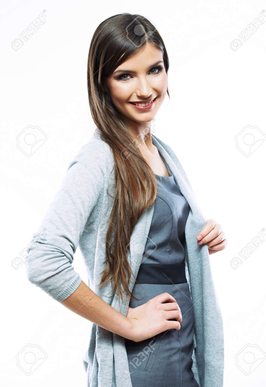 Business woman standing against white background. Smiling female business model studio posing. - 128105886