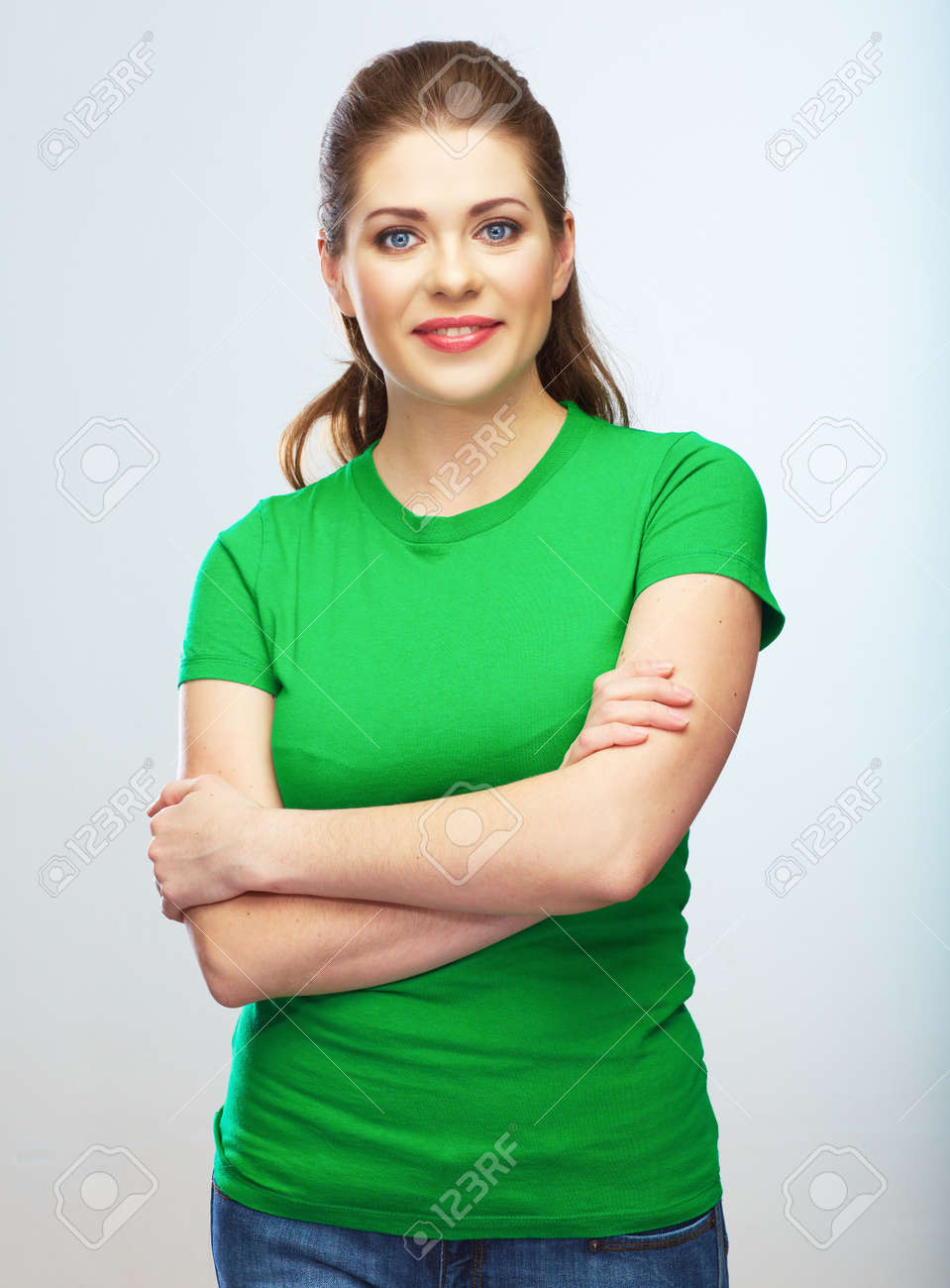 Young woman isolated portrait, green dressed female model. - 134020215
