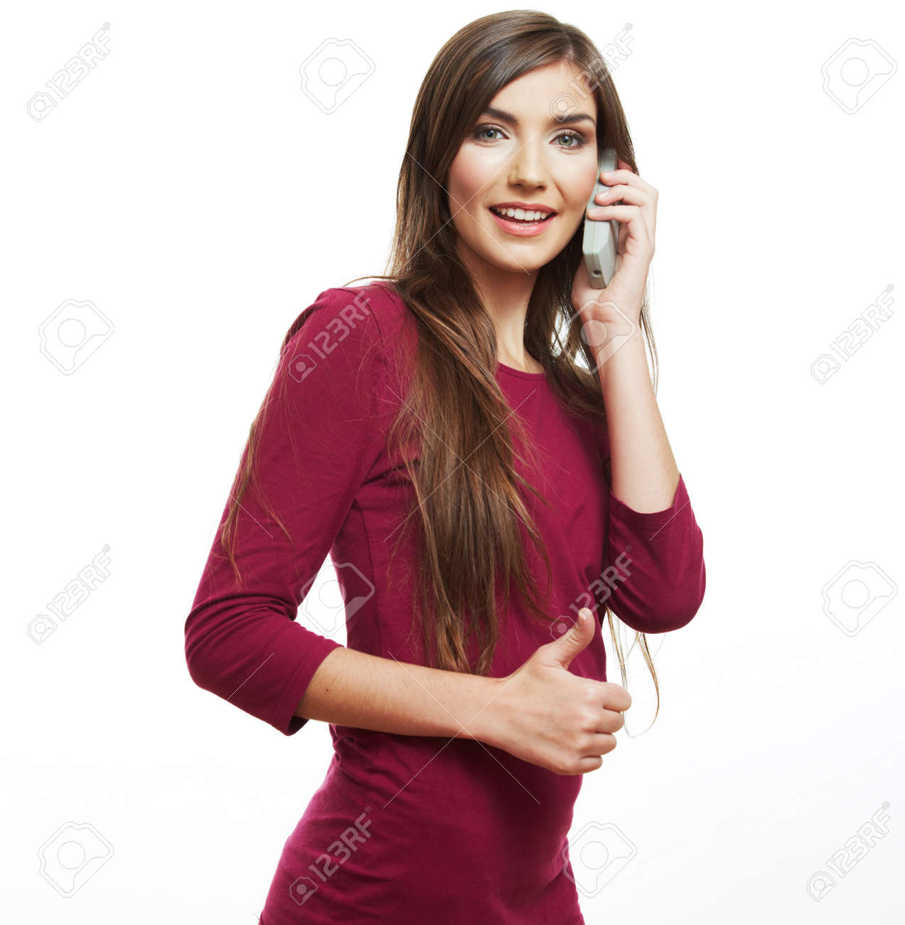 Young casual style woman portrait using phone, isolated over white background. - 134128703
