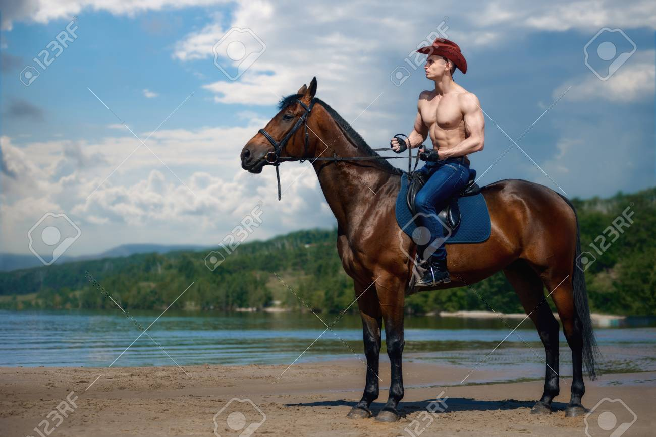 Macho Man Handsome Cowboy Riding On A Horse On The Background Stock Photo Picture And Royalty Free Image Image 83815392