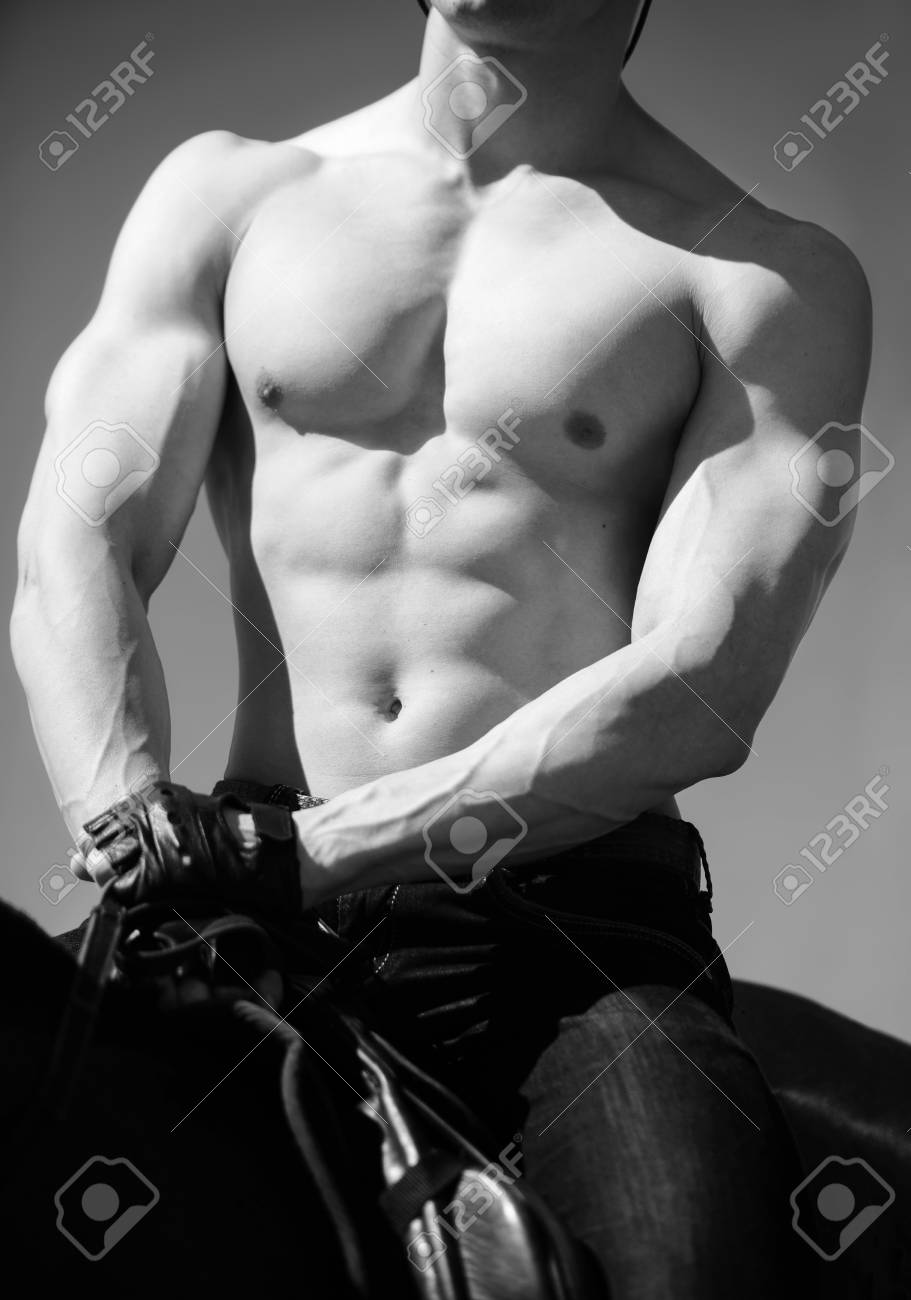 Very Hot Sexy Muscular Torso Of A Male Rider On Horseback Close Up