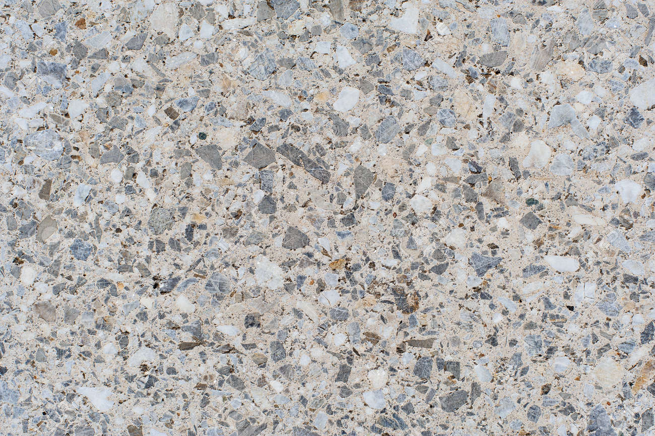 The Texture Or Background Of A Light Granite Tile Interspersed