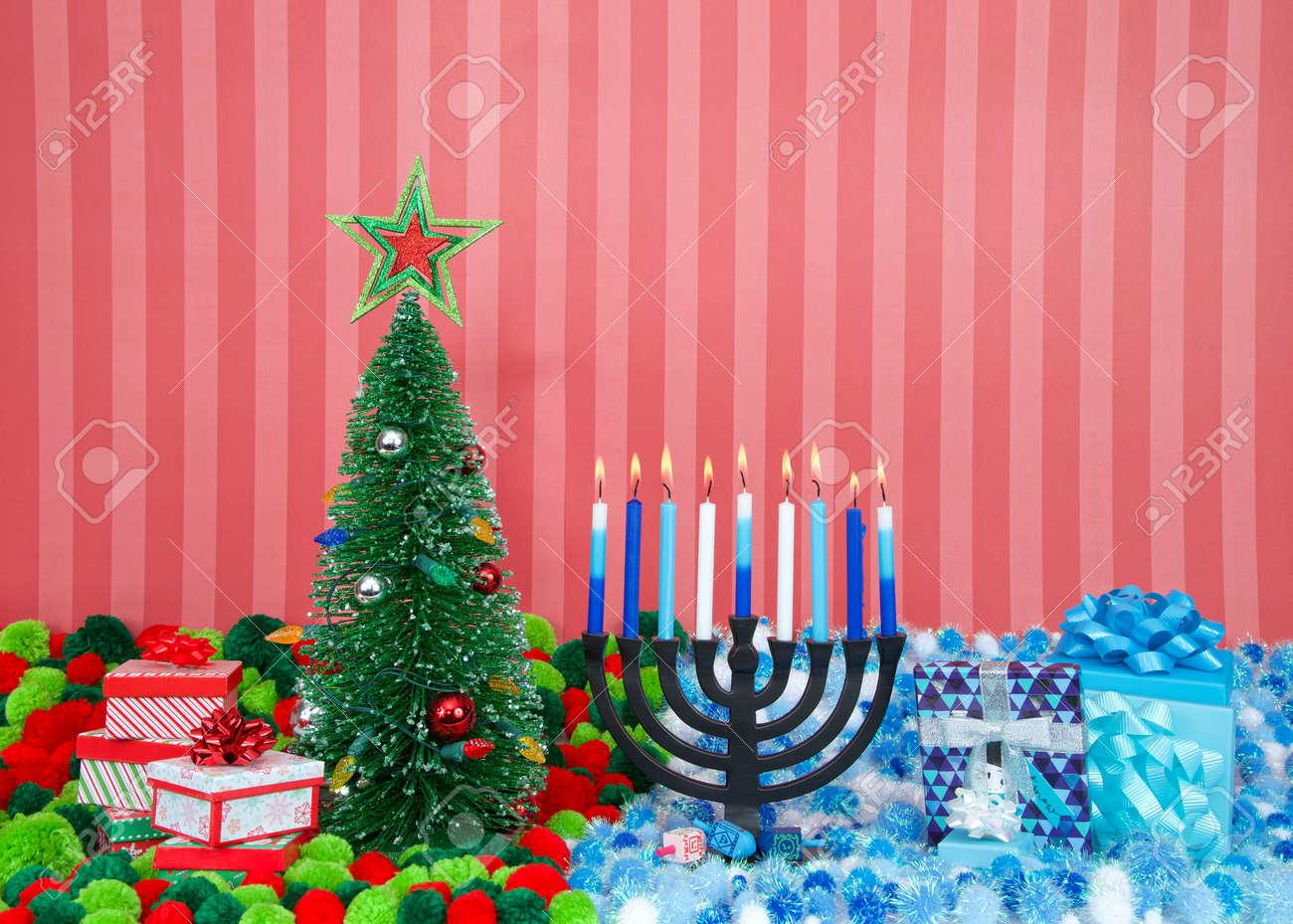 Christmas Hannakah.Christmas Tree With Presents Next To Hanukkah Menorah Burning