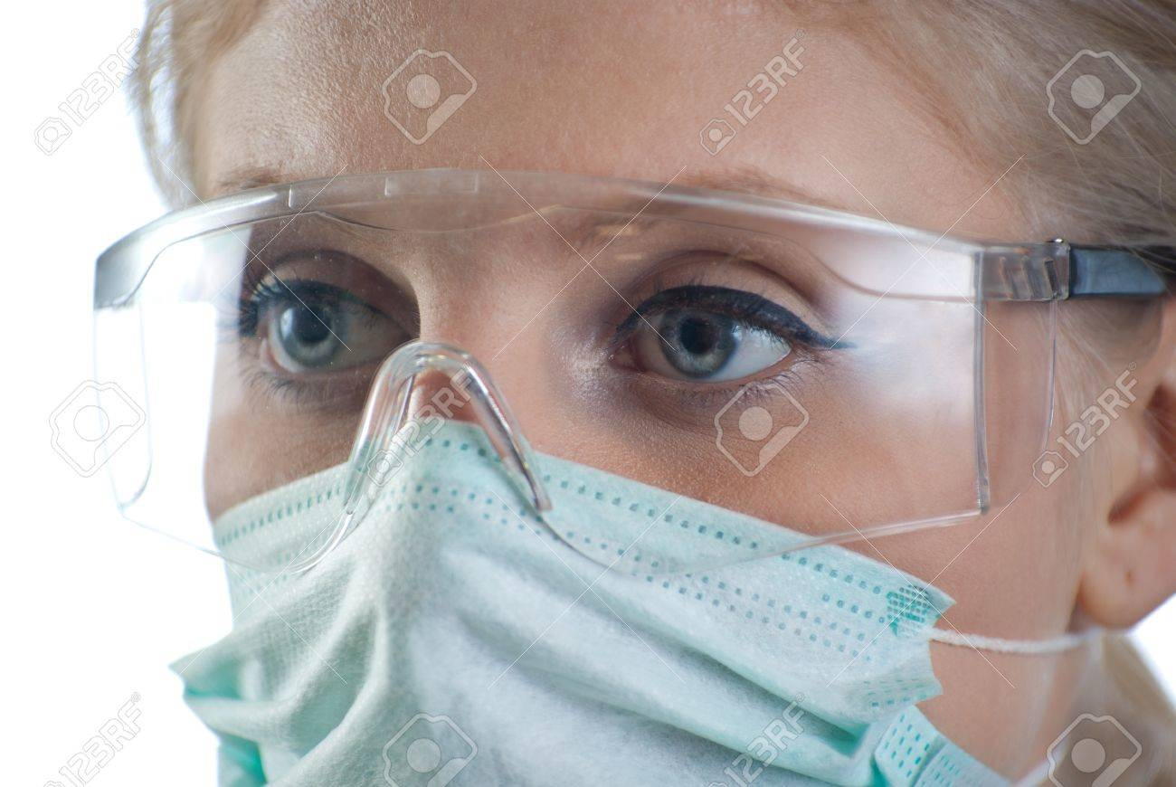 A doctor wearing a mask and eyewear on white background Stock Photo - 9240207